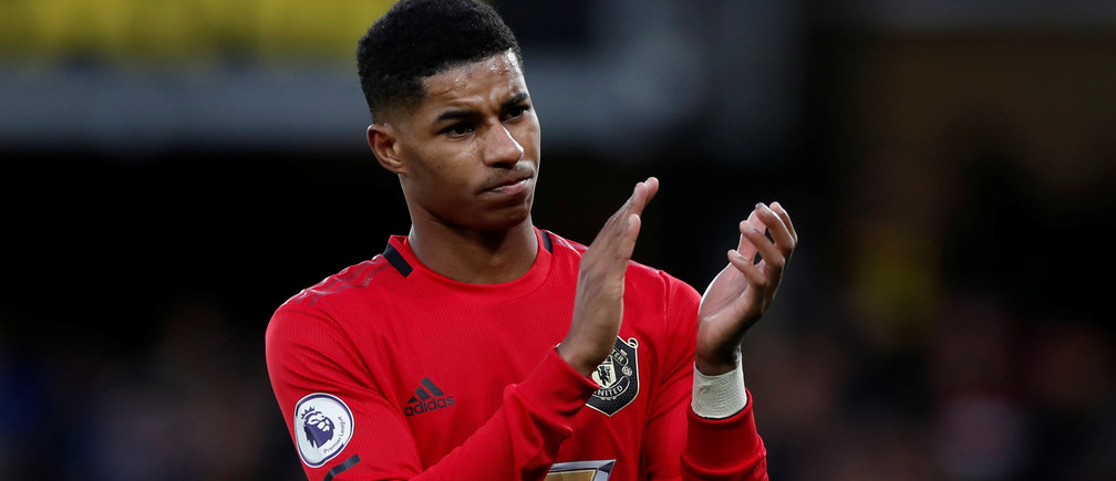 """Soccer Football - Premier League - Watford v Manchester United - Vicarage Road, Watford, Britain - December 22, 2019  Manchester United's Marcus Rashford applauds fans after the match   Action Images via Reuters/Paul Childs  EDITORIAL USE ONLY. No use with unauthorized audio, video, data, fixture lists, club/league logos or """"live"""" services. Online in-match use limited to 75 images, no video emulation. No use in betting, games or single club/league/player publications.  Please contact your account representative for further details. - RC2F0E9QJSTT"""