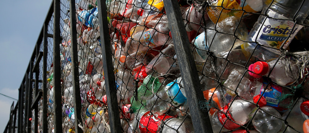 Recyclable plastic soft drink bottles are seen outside at a recycling warehouse, in Mexico City, Mexico August 18, 2017. REUTERS/Henry Romero - RC174A5CFA60