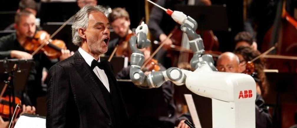 Humanoid robot YuMi conducts the Lucca Philharmonic Orchestra performing a concert alongside Italian tenor Andrea Bocelli at the Verdi Theatre in Pisa, Italy September 12, 2017. REUTERS/Remo Casilli - RC13DD7635E0