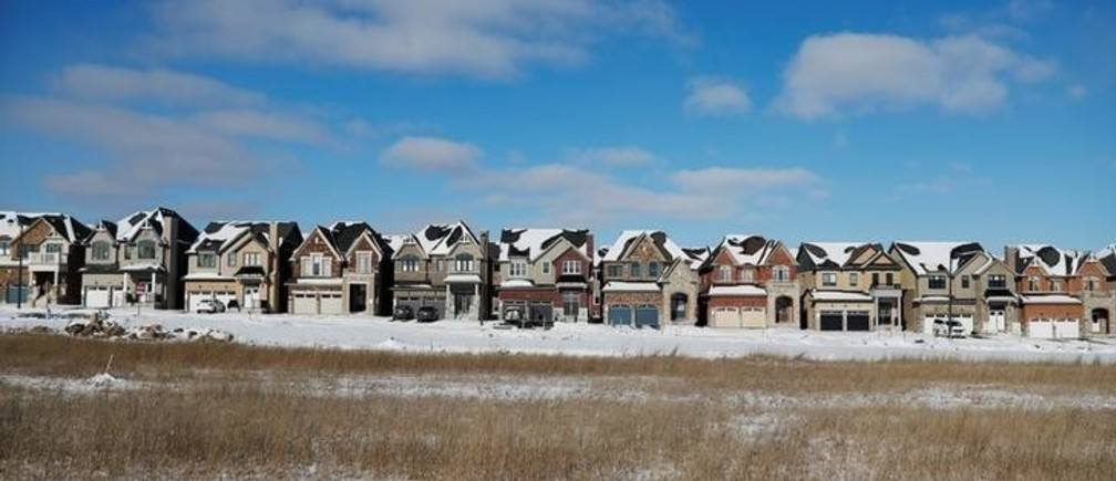 A row of houses stand in a newly built subdivision in East Gwillimbury, Ontario, Canada, January 30, 2018. Picture taken January 30, 2018.    REUTERS/Mark Blinch