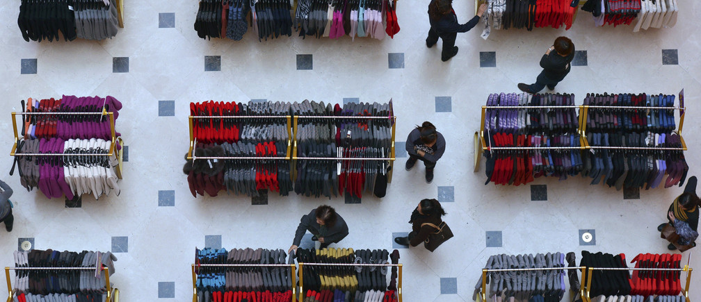 Customers shop inside a department store in Shenyang, Liaoning province, November 6, 2013.