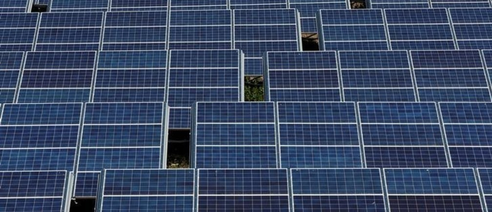 Solar panels to produce renewable energy are seen at the Urbasolar photovoltaic park in Gardanne, France, June 25, 2018.    REUTERS/Jean-Paul Pelissier