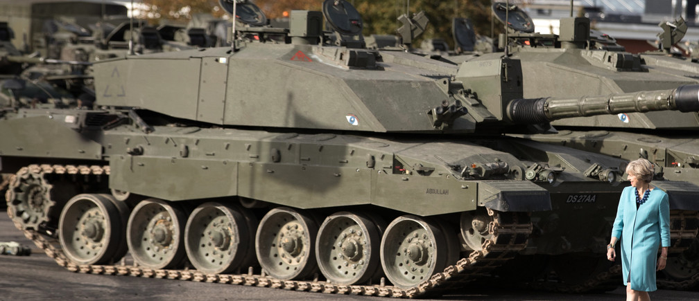 Prime Minister Theresa May passes tanks as she visits 1st Battalion The Mercian Regiment (Cheshire, Worcesters and Foresters, and Staffords) at their barracks at Bulford Camp on September 29, 2016 near Salisbury, England.  The Prime Minister visited the military base in the Salisbury Plain area to meet with soldiers, see the equipment they work with and to also meet with some their families. REUTERS/Matt Cardy/Pool - LR1EC9T190RK3