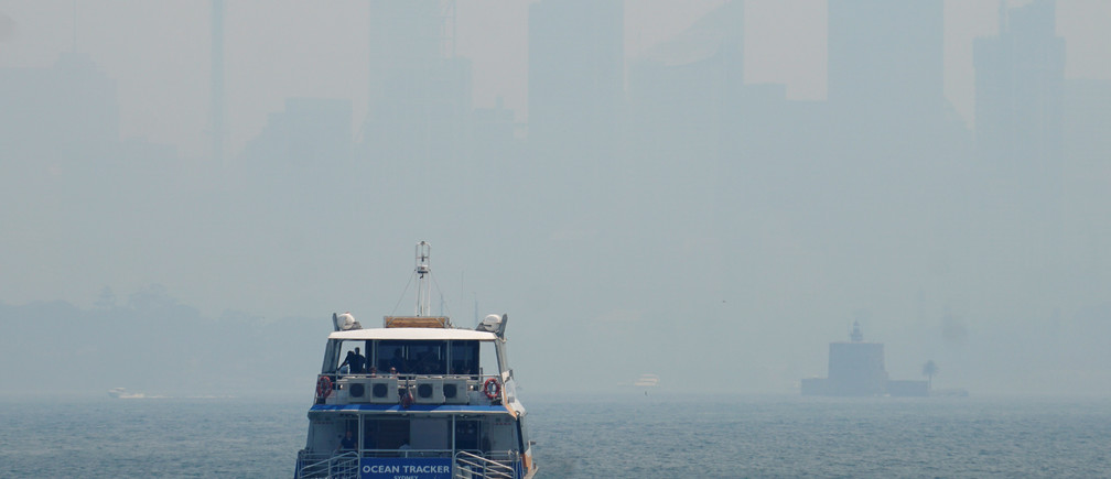 Sydney's skyline is barely visible through smoke haze from bushfires.