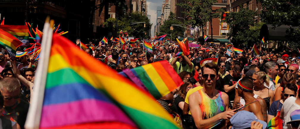 Marchers walk down 5th Avenue as they part in the 2019 World Pride NYC and Stonewall 50th LGBTQ Pride Parade in New York, U.S., June 30, 2019. REUTERS/Lucas Jackson - RC11F7DEE8E0