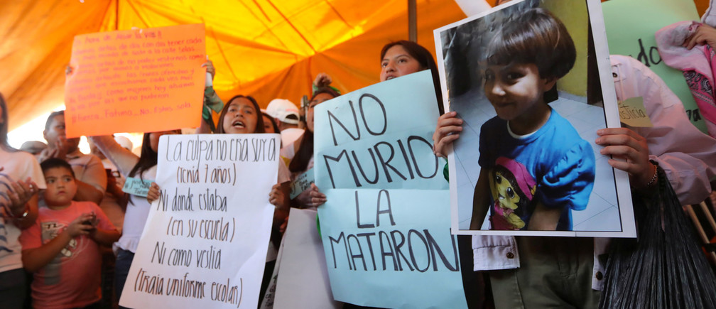 Activists hold placards at the home of Fatima Cecilia Aldrighett, 7, who went missing on February 11 and whose body was discovered over the weekend inside a plastic garbage bag, in Mexico City, Mexico, February 17, 2020. REUTERS/Edgard Garrido - RC2P2F96GQK1