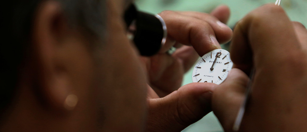 A watch repairer looks at the watch face while doing adjustments at a workshop in Mexico City, Mexico January 25, 2018. REUTERS/Daniel Becerril - RC1F4CDF7C70