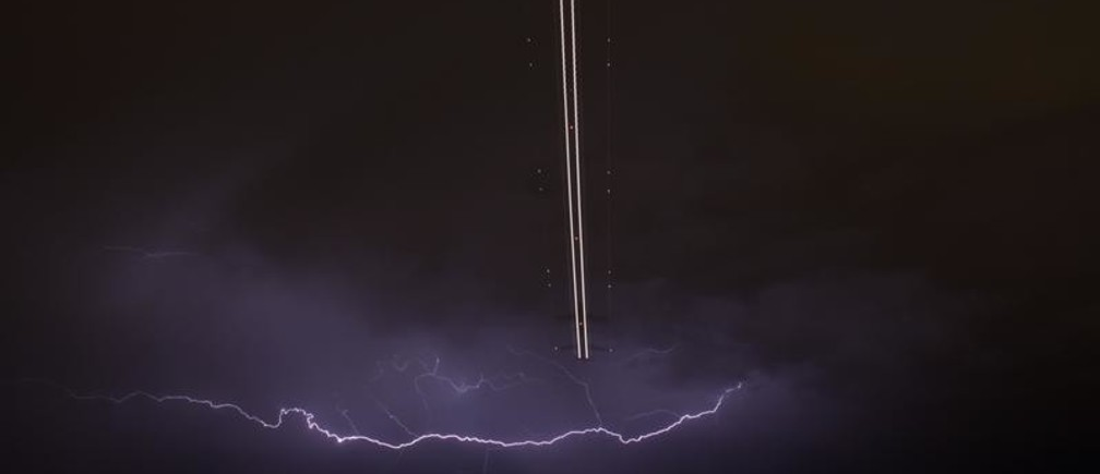 A jet aircraft takes off as lightning strikes across the sky during a monsoon storm at McCarran International Airport in Las Vegas, Nevada July 7, 2014. Picture taken July 7.         REUTERS/Gene Blevins  (UNITED STATES - Tags: ENVIRONMENT TRANSPORT SOCIETY) - GM1EA781ANE01
