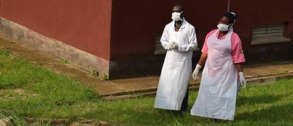 Ugandan medical staff are seen as they inspect the ebola preparedness facilities at the Bwera general hospital near the border with the Democratic Republic of Congo in Bwera, Uganda, June 12, 2019. REUTERS/Samuel Mambo     TPX IMAGES OF THE DAY - RC11FFFCD990