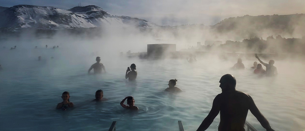 Bathers enjoy the warm volcanic hot springs of the Blue Lagoon in Grindavik, Iceland, March 6, 2020. REUTERS/Hannah McKay     TPX IMAGES OF THE DAY - RC2KEF99UT8I