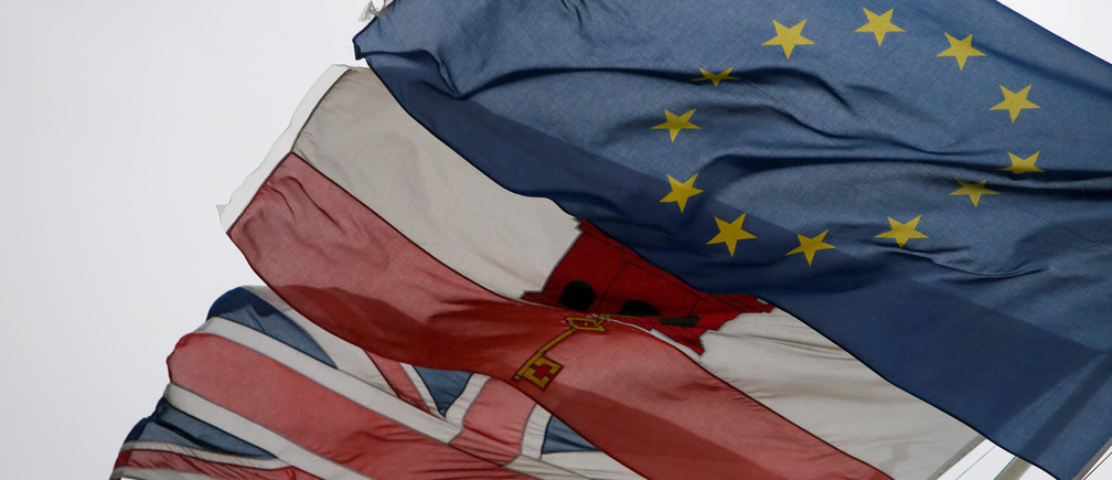 The European Union flag flies alongside the Gibraltarian flag and Britain's Union Jack in the British overseas territory of Gibraltar, historically claimed by Spain, November 22, 2018.    REUTERS/Jon Nazca - RC1E3265D290