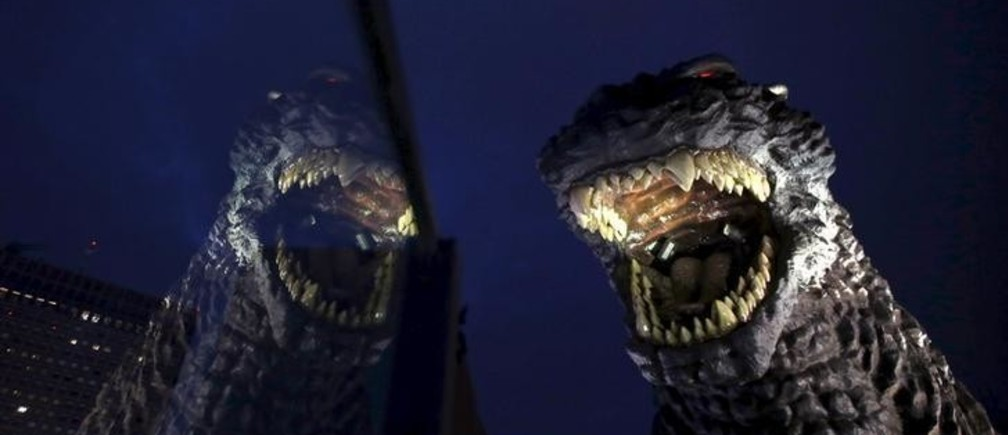 A real-scale head of Godzilla is displayed at the balcony of a newly-built commercial complex as a new Tokyo landmark during its unveiling at Kabukicho shopping and amusement district in Tokyo April 9, 2015. The skyscraper complex which includes a hotel, movie theatres and restaurants will be open this month in central Tokyo. REUTERS/Issei Kato