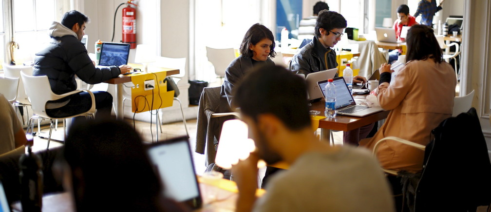 """Participants of the """"Start Up Chile"""" program work at their headquarters in Santiago, August 10, 2015."""