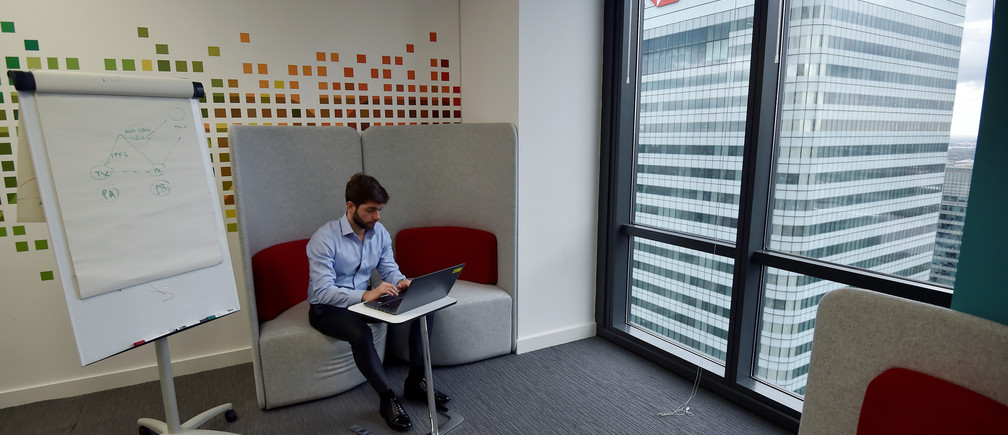 """A UBS employee works in the UBS """"fintech lab"""" at Canary Wharf in London, Britain, October 19, 2016. REUTERS/Hannah McKay - RTX2PJIZ"""