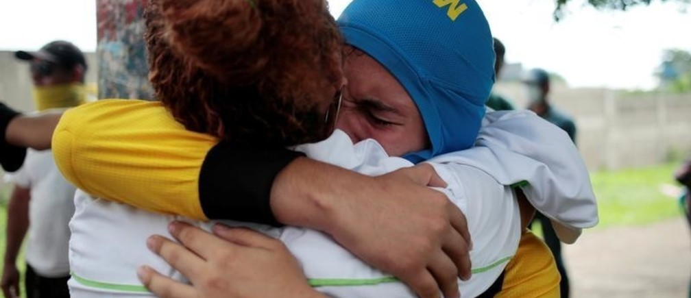 A demonstrator embraces his mother during a protest against Nicaraguan President Daniel Ortega's government in Managua, Nicaragua May 31, 2018.