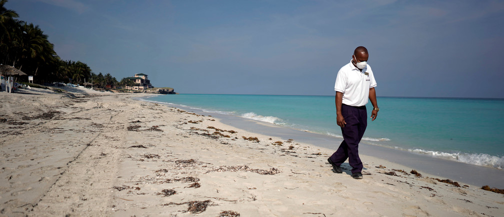 A security agent walks on the beach in Varadero, Cuba.