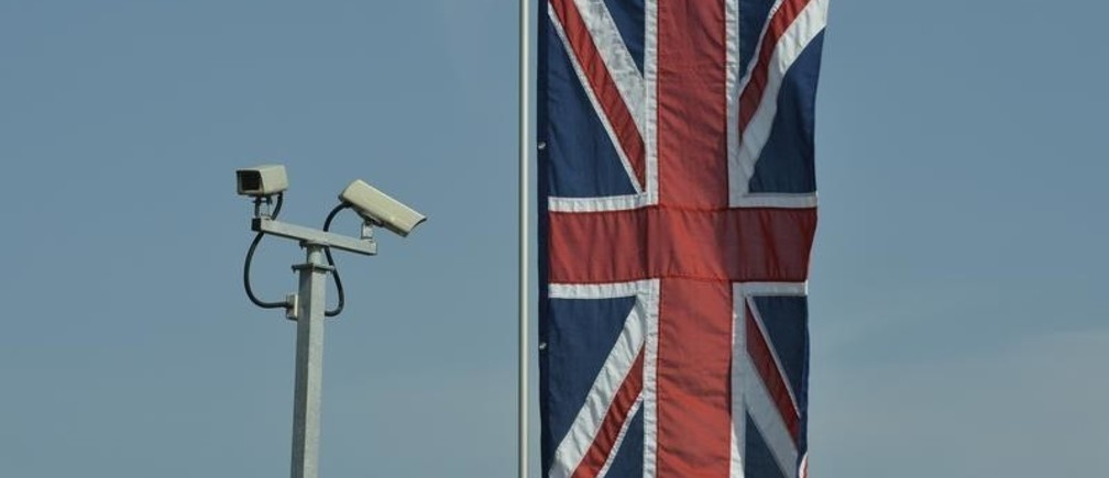 Security cameras and a British Union flag are seen outside the Krishna Avanti School, before a visit by Britain's Queen Elizabeth, in Edgware, north London March 29, 2012. The visit is part of the Queen's tour of Britain to celebrate her Diamond Jubilee.   REUTERS/Toby Melville (BRITAIN - Tags: ENTERTAINMENT EDUCATION SOCIETY ROYALS) - LM1E83T13EM01