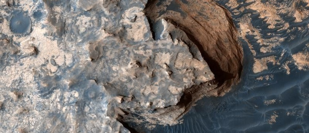 An image acquired by the High Resolution Imaging Science Experiment (HiRISE) camera aboard NASA's Mars Reconnaissance Orbiter on April 18, 2017, shows a rugged cliff edge. Image released June 22, 2017.