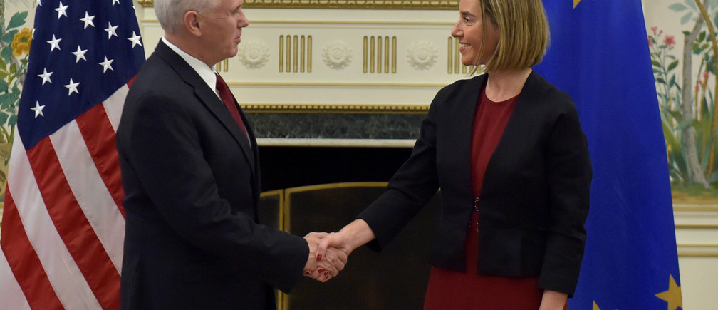 U.S. Vice President Mike Pence shakes hands with European Union foreign policy chief Federica Mogherini in Brussels, Belgium, February 20, 2017. REUTERS/Eric Vidal - RTSZGAG