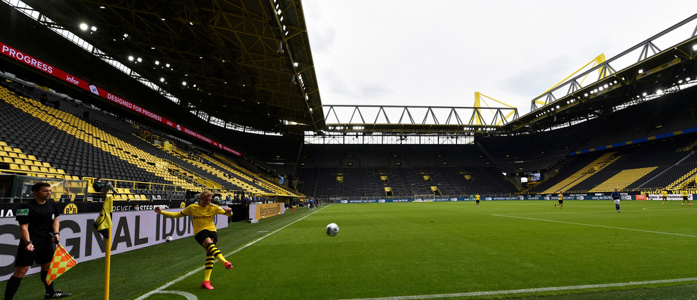 Soccer Football - Bundesliga - Borussia Dortmund v Schalke 04 - Signal Iduna Park, Dortmund, Germany - May 16, 2020 Dortmund's Erling Haaland kicks the ball, as play resumes behind closed doors following the outbreak of the coronavirus disease (COVID-19) Martin Meissner/Pool via REUTERS  DFL regulations prohibit any use of photographs as image sequences and/or quasi-video - RC2XPG9GXCOL