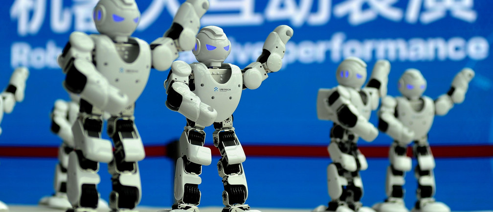 Ubtech robots perform a synchronised dance at the World Intelligent Manufacturing Summit in Nanjing, China.