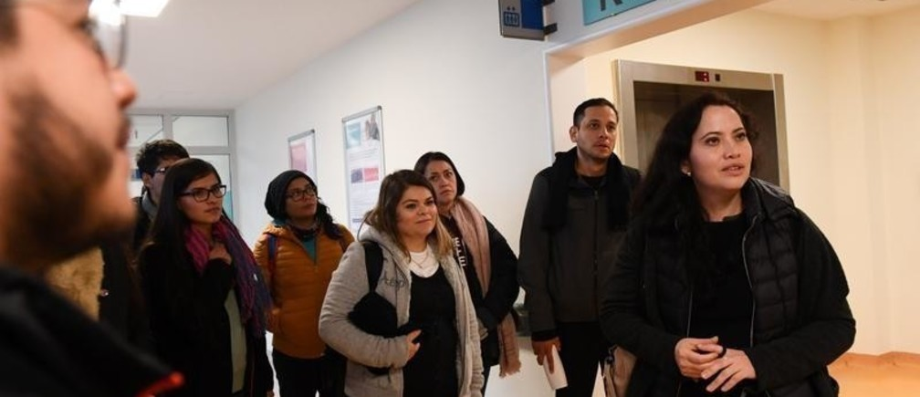 A group of people from Mexico with academic nursing training takes an introductory tour of the Helios Clinic area in Schwerin, Germany, January 8, 2020. Recruiting foreign specialists is a means against the shortage of skilled workers in the nursing sector. Picture taken January 8, 2020.  REUTERS/Annegret Hilse - RC22DE9SQGFM