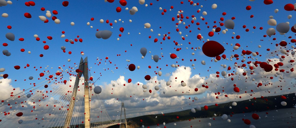 Red and white balloons are released during the opening ceremony of newly built Yavuz Sultan Selim bridge, the third bridge over the Bosphorus linking the city's European and Asian sides in Istanbul, Turkey, August 26, 2016.