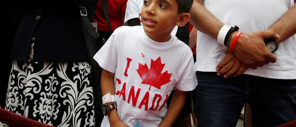 A Syrian refugee waits to shake hands with Canada's Prime Minister Justin Trudeau (not pictured) during Canada Day celebrations on Parliament Hill in Ottawa, Ontario, Canada, July 1, 2016. REUTERS/Chris Wattie - RTX2JALH