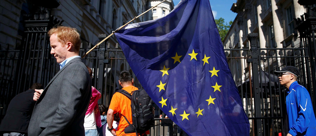 man carries a EU flag, after Britain voted to leave the European Union, outside Downing Street in London, Britain June 24, 2016.