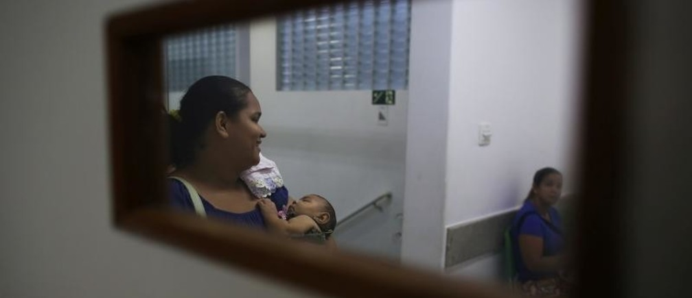 "Jaqueline, 25, holds her five-month-old daughter Laura as they wait for a session with a physiotherapist at the Casa da Esperanca Hospital (Hope House Hospital) in Santos, Sao Paulo state, Brazil April 20, 2016. Among the mysteries facing doctors in Brazil battling an epidemic of the little-known Zika virus are cases of women giving birth to twins with only one suffering from microcephaly, a birth defect associated with the disease. Jaqueline Jessica Silva de Oliveira hoped doctors were wrong when a routine ultrasound showed that one of her unborn twins would be born with the condition, marked by stunted head size and developmental issues. ""When I found out one of them had microcephaly the ground fell out from beneath me,"" she said. Laura was born with the microcephaly while her twin brother Lucas does not suffer from the condition."
