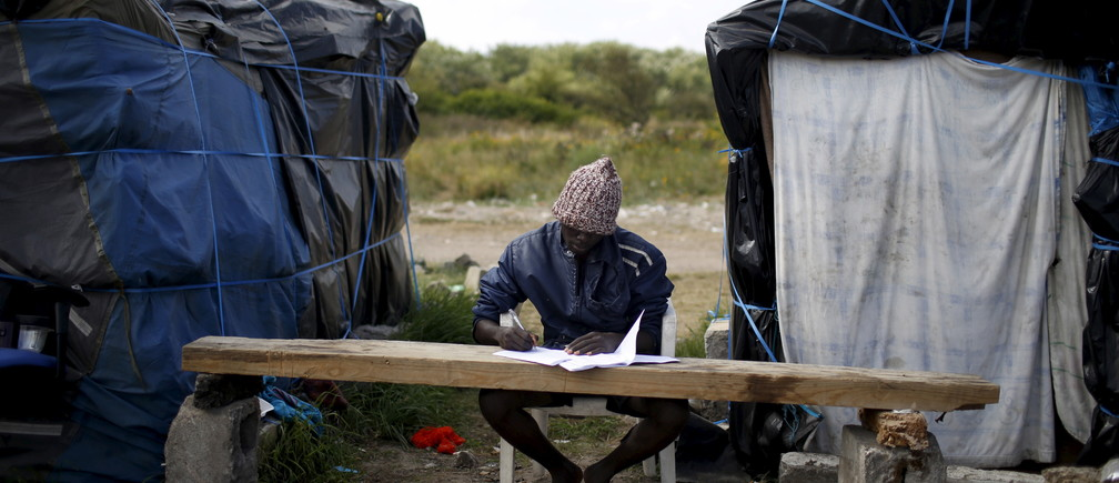"Faris, from Sudan, learns French at ""The New Jungle"" camp in Calais, France, August 8, 2015."