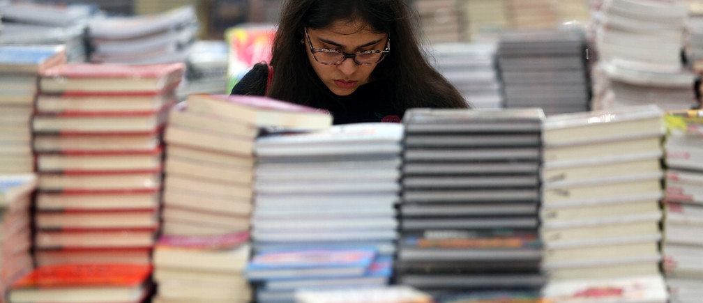 A visitor reads a book at the Big Bad Wolf Book Sale, which calls itself the world's biggest, hosted for the first time by Dubai, UAE  October 17, 2018. Picture taken October 17, 2018. REUTERS/Satish Kumar - RC156B67C8F0