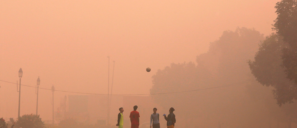 Boys play football in a public park on a smoggy morning in New Delhi, India, November 2, 2016. REUTERS/Adnan Abidi     TPX IMAGES OF THE DAY      - RTX2RHUG