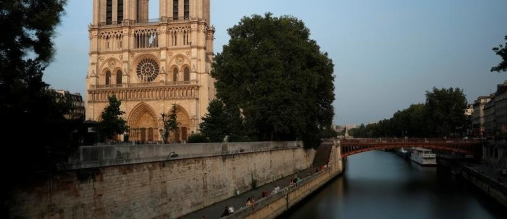 A general view shows the Notre Dame Cathedral on the edge of the Seine river in Paris, France, August 28, 2017. Officials at the 854-year old Notre-Dame cathedral, France's most-visited monument, say it is in urgent need of raising 100 million euros ($120.40 million) to repair everything from damaged arches and statutes to broken down gargoyles. Picture taken with long time exposure.   REUTERS/Philippe Wojazer - RC12E5715CE0