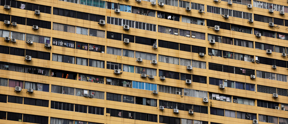 Air conditioning units dot the facade of a residential apartment block in Singapore April 6, 2017. REUTERS/Edgar Su - RC17A0A00130