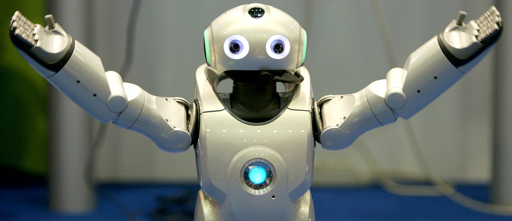 A robot gestures during a demonstration of its skill during the seventh  Soccer World Championship for Robots in Padua, northern Italy, July 9, 2003. Robocup is an international research and education initiative aimed at fostering artificial intelligence and robotics research. - PBEAHUOOLBQ