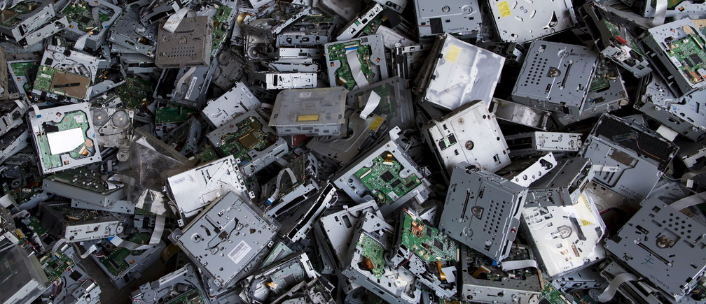 CD players for recycling are seen at a workshop in Guangdong, China.