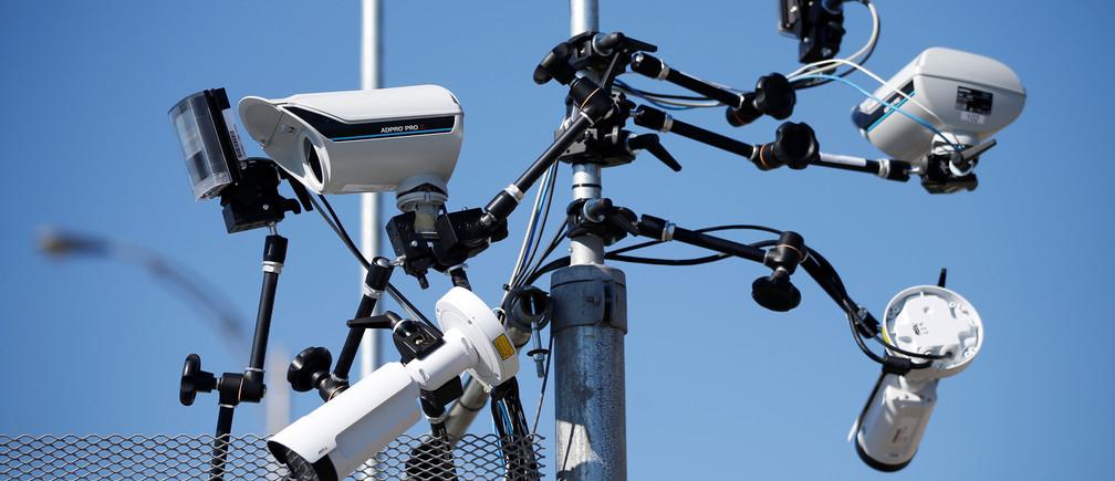 Surveillance cameras on a security fence in Quebec, Canada.