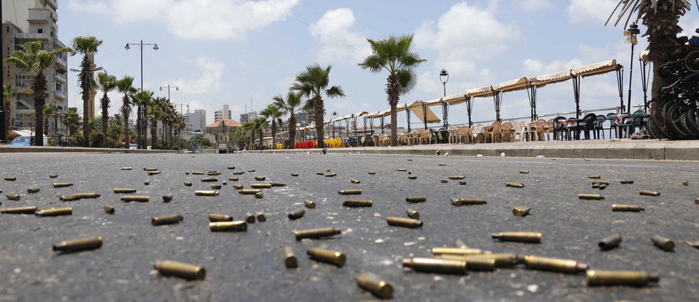 Bullet casings are seen on a street, during clashes with gunmen of hardline Sunni Muslim cleric Sheikh Ahmed al-Assir, in Sidon, southern Lebanon, June 24, 2013.