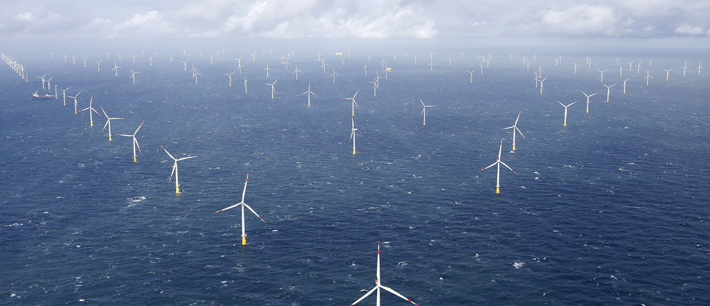 Power-generating windmill turbines are pictured at the 'Amrumbank West' offshore windpark in the northern sea near the island of Amrum, Germany September 4, 2015.