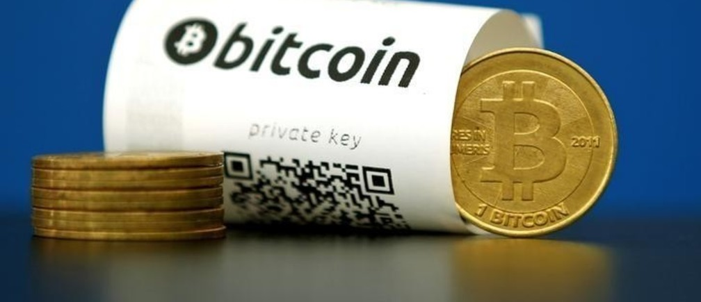 A Bitcoin (virtual currency) paper wallet with QR codes and a coin are seen in an illustration picture taken at La Maison du Bitcoin in Paris, France, May 27, 2015.