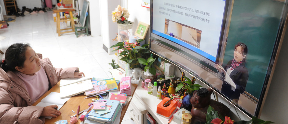A student attends an online class at home as students' return to school has been delayed due to the novel coronavirus outbreak, in Fuyang, Anhui province.