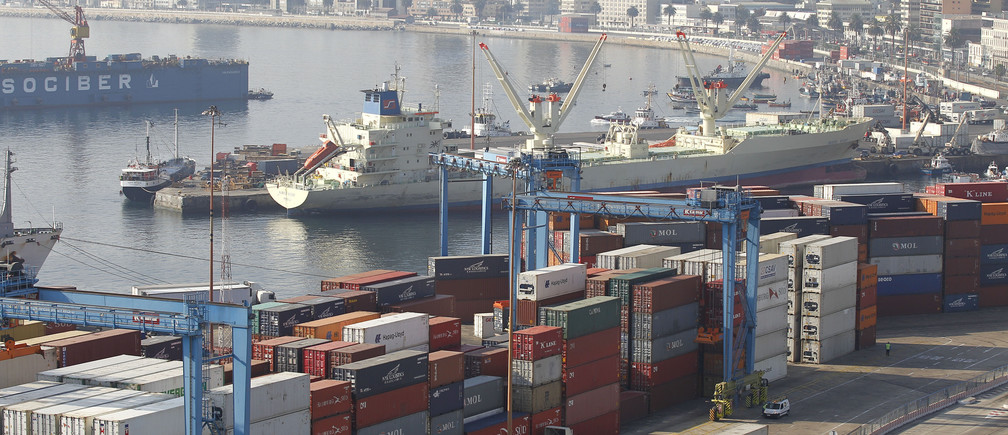 An unladen container ship is pictured among containers during a strike by port workers against the government in Valparaiso port, about 121 km (75 miles) northwest of Santiago, April 5, 2013.