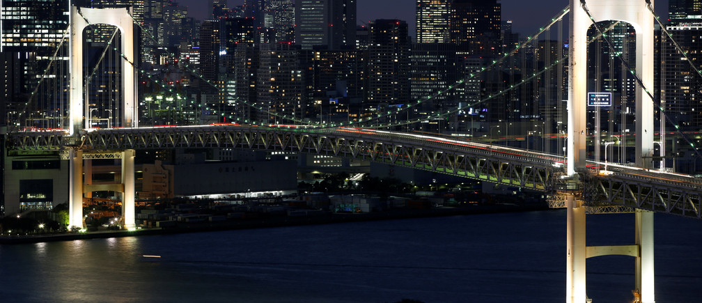 The Rainbow Bridge is seen with Tokyo's skyscrapers in the background in Tokyo, Japan November 14 2018.   REUTERS/Issei Kato - RC15093CF270