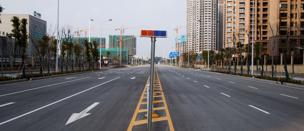 An empty street is seen in Yueyang, Hunan Province, near the border to Hubei Province, which is under partial lockdown after an outbreak of a new coronavirus, in China January 28, 2020.