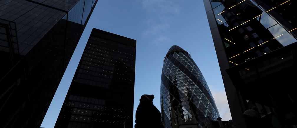 A pedestrian walks past skyscrapers in the financial district in London, Britain February 17, 2020. REUTERS/Simon Dawson - RC2H2F97GPZC