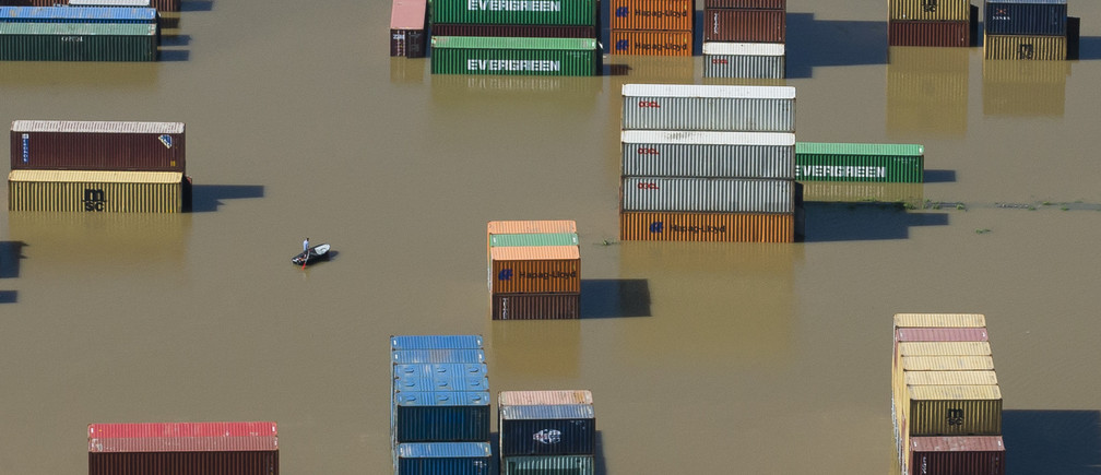Shipping containers are partly immersed in water at the flooded harbour in Riesa in the federal state of Saxony after the Elbe river broke its banks, June 5, 2013