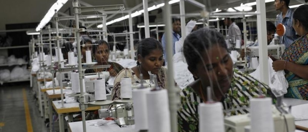 """Employees sew clothes at the Estee garment factory in Tirupur, in the southern Indian state of Tamil Nadu June 19, 2013. With knitwear exports of over $2 billion a year, India's garment manufacturing hub Tirupur has earned the nickname """"Dollar City,"""" but its allure for price-conscious global retailers obsessed by discounts of as little as one U.S. cent pales before Bangladesh"""