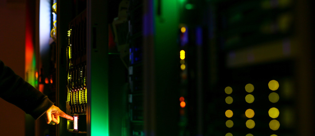 A man poses inside a server room at an IT company in this June 19, 2017 illustration photo. REUTERS/Athit Perawongmetha/Illustration - RC159C4FB990