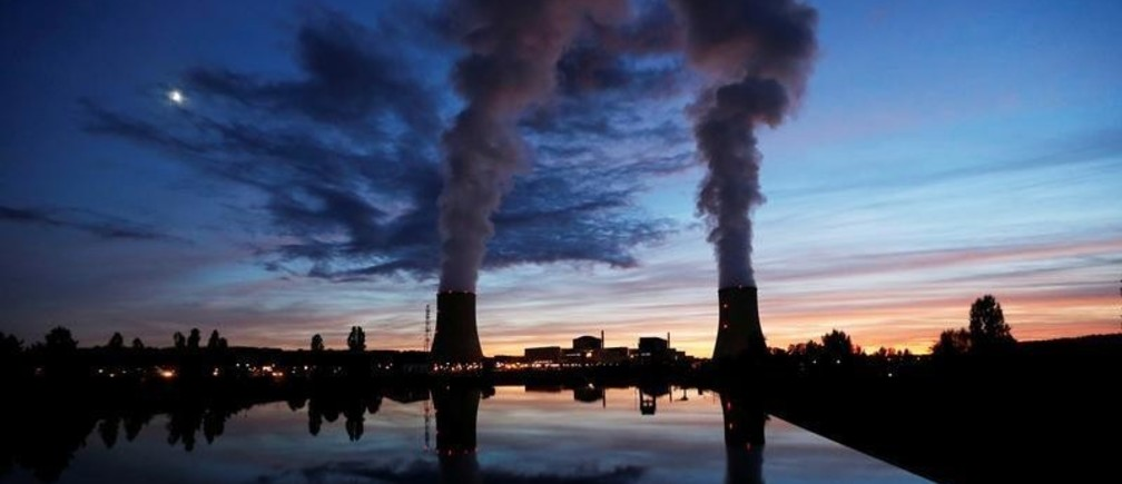 Cooling towers at the Golfech nuclear plant are pictured during sunset on the edge of the Garonne river between Agen and Toulouse, France, September 26, 2017. REUTERS/Regis Duvignau - RC11A18F6210